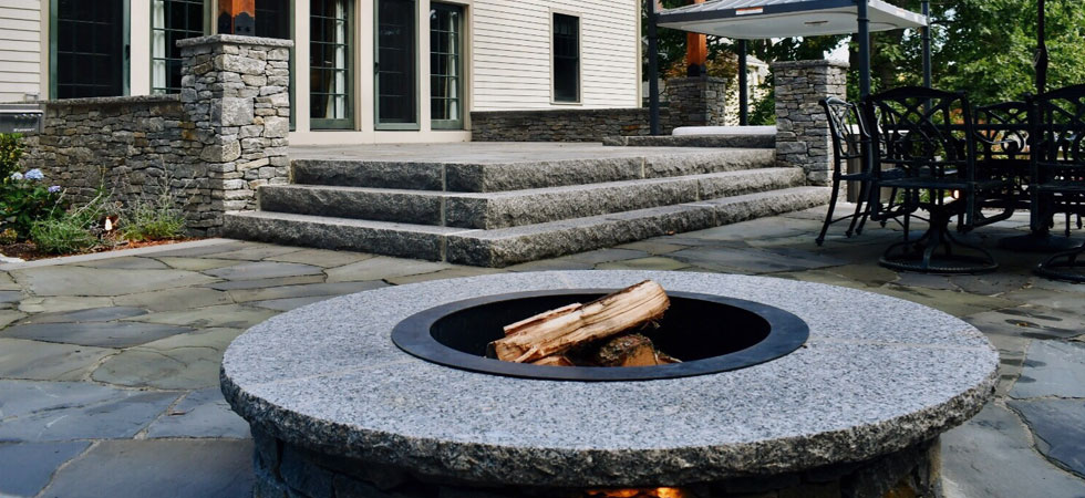 granite fileplace, stone steps, and outdoor patiol